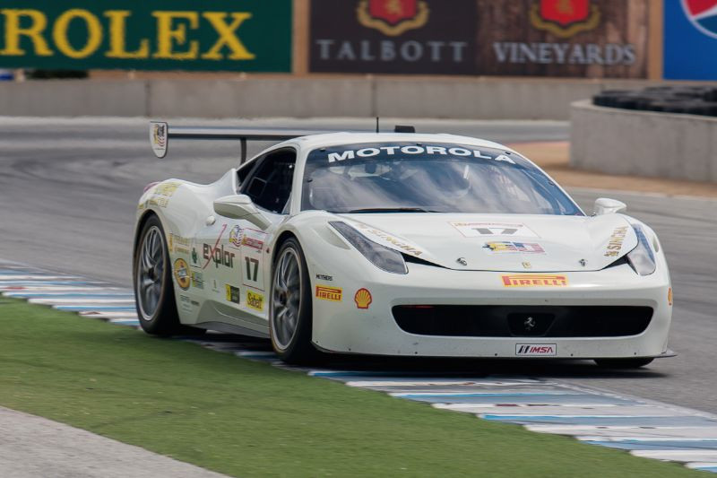 Patrick Byrne runs on the curb as he races down the front straight in the #17 Ferrari 458 EVO