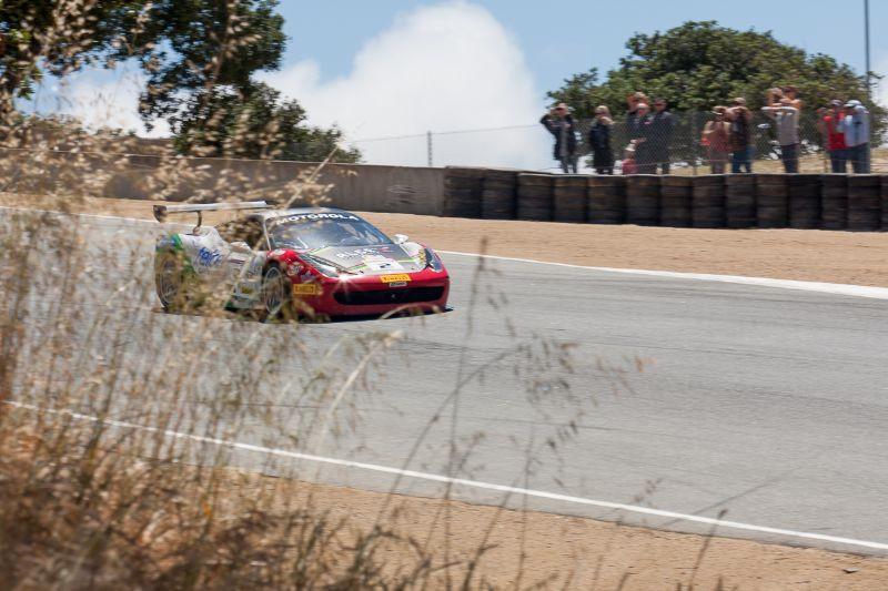 Ricardo Perez passes spectators as he exits the Corkscrew in the #2 Ferrari 458 EVO