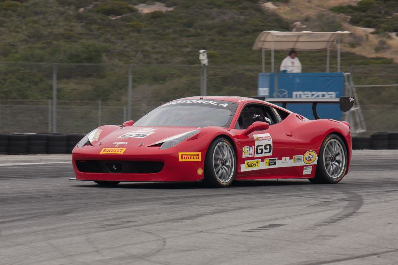 Michael Macs exits turn 11 and onto the front straight in the #69 Ferrari 458 EVO