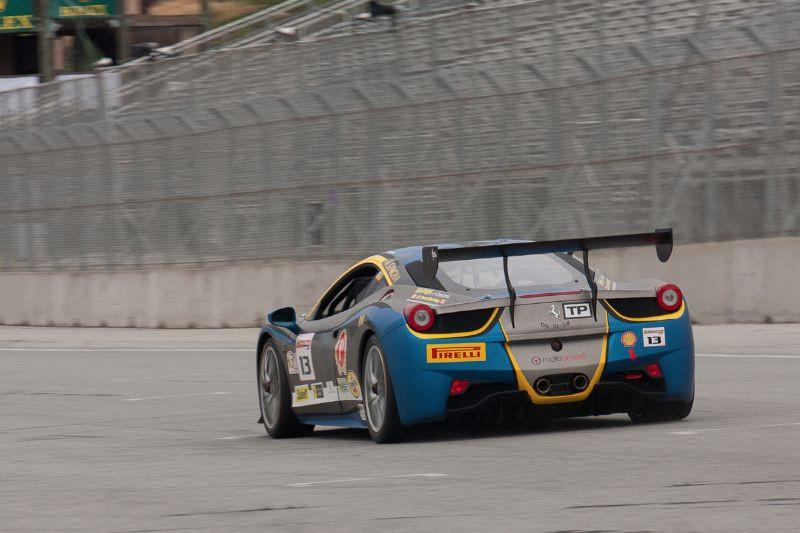 Marc Muzzo race down the front straight in the #13 Ferrari 458 EVO