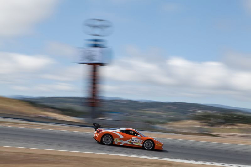 Robert Herjavec rounds turn ten in the #077 Ferrari 458 EVO