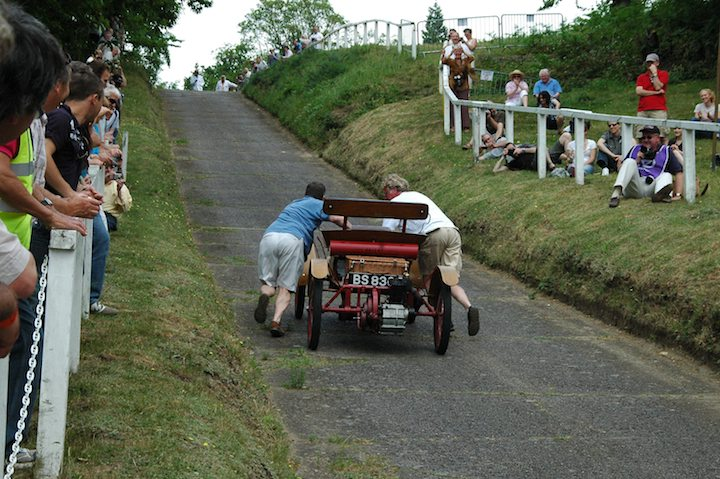 pushing-the-1904-orient-buckboard-up-the-hill