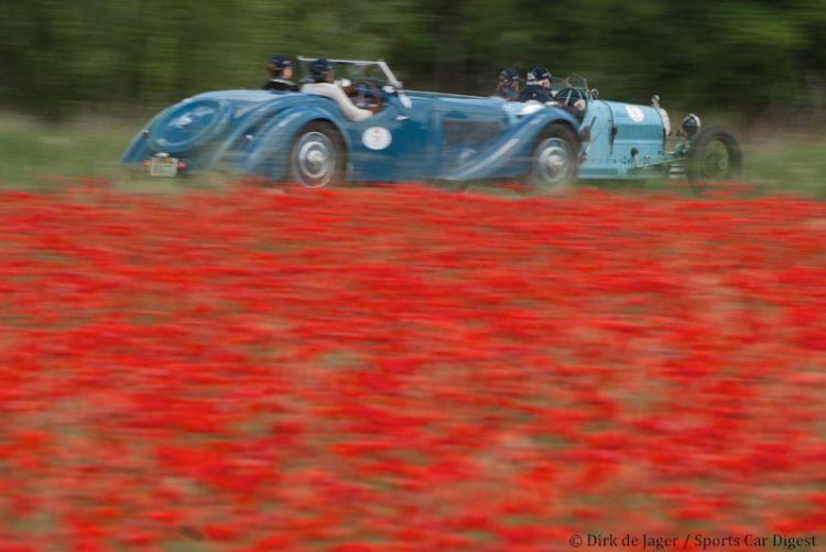 1926-bugatti-t37-sn-37128-passing-1937-bugatti-t57s-corsica-roadster-sn-57531
