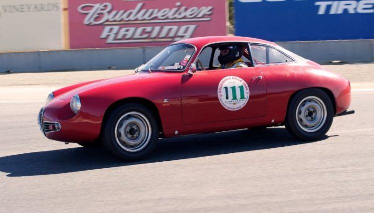 Camilo Swig in her 1959 Alfa Romeo SZ.