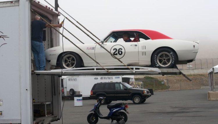 Pre-Reunion,Friday. Ex-Jerry Titus 1968 Pontiac Firebird exits the transporter.