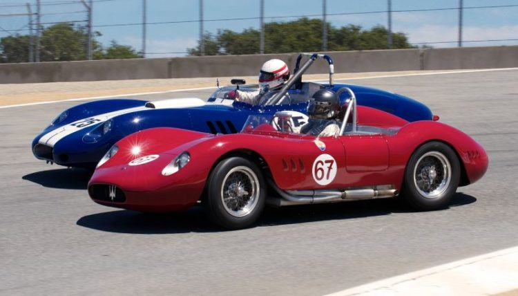 Pre-Reunion Saturday. Going into the Corkscrew with inches to spare. Ned Spieker's 1957 Maserati 200SI inside Erickson Shirley's 1959 Lister Costin Cheverolet.