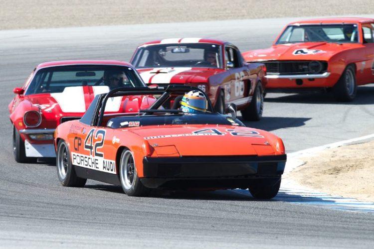 Edie Arrowsmith's Porsche 914/6 leads in two.