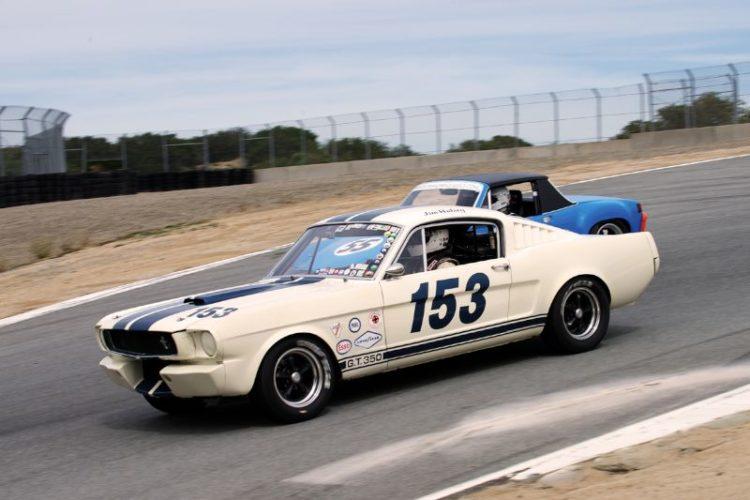 Jim Halsey's 1965 Shelby GT 350 leads Mark Leonard's 1970 914/6 into the Corkscrew.