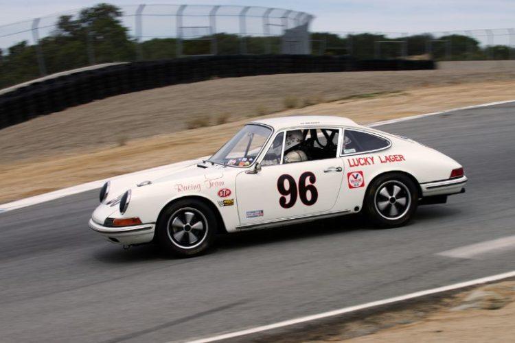 Ed Matsuishi's 1965 Porsche 911R drops off into the Corkscrew.
