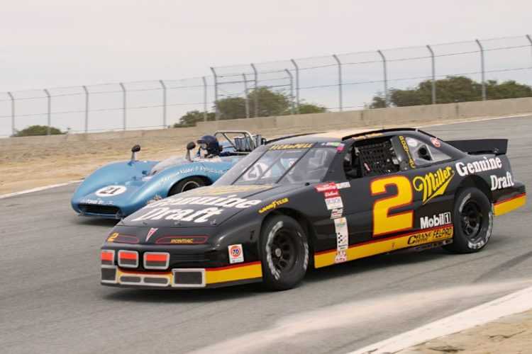 'Strange Bedfellows' but as so often happens with 'Strange Bedfellows' great fun to watch. Tom Klauer's Pontiac Grand prix and Nick Colonna's Lola T70.