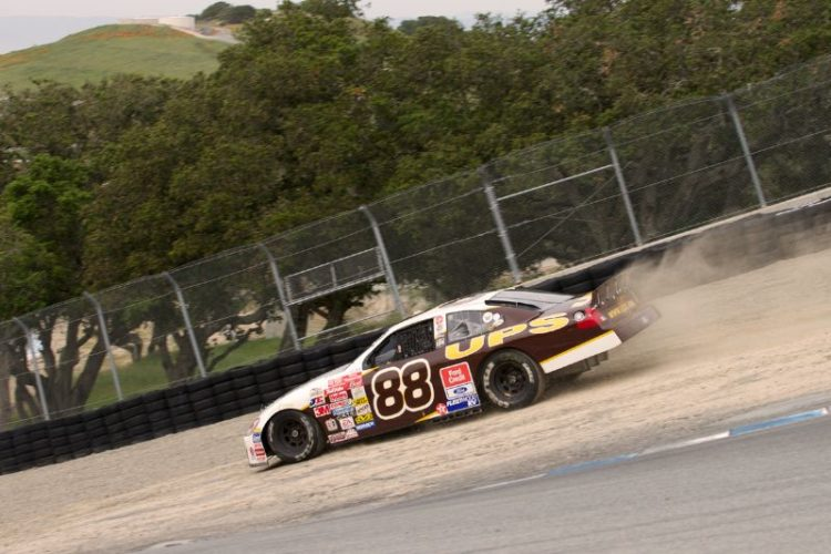 Dan Verstuyft's 2001 Ford Taurus dirt tracks off The Corkscrew.