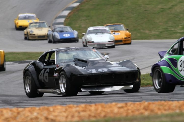 Jody O'Donnell, 69 Corvette, surrounded by Porsches.