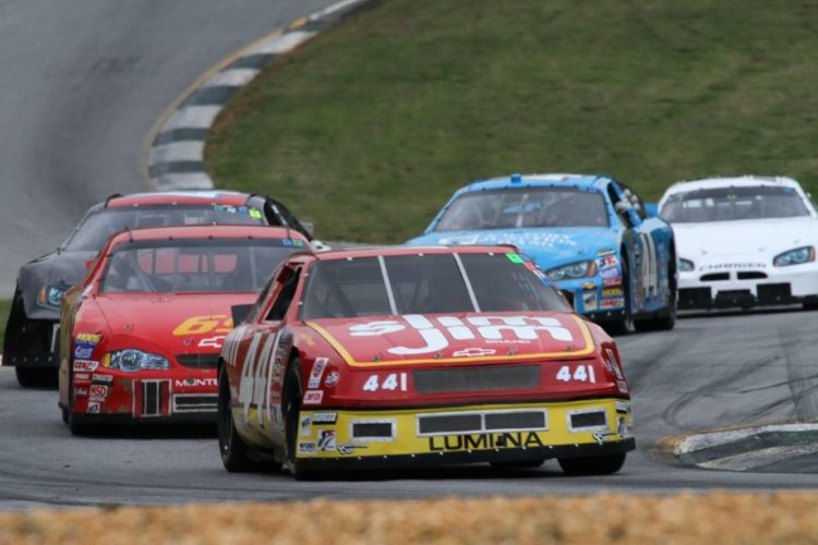 Gary Stach, 92 Chevy Lumina, leads a group of historic stock cars through turn 5.