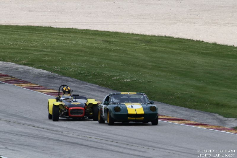 Denny Wilson, 62 Lotus Super 7 challenges Norbert Bries, 70 Lotus Europa for the lead in Group 2.