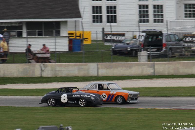 Last turn, last lap. Paul Swanson, 58 Porsche 356 challenges Richard Fisher, 67 Datsun Bluebird, for position.