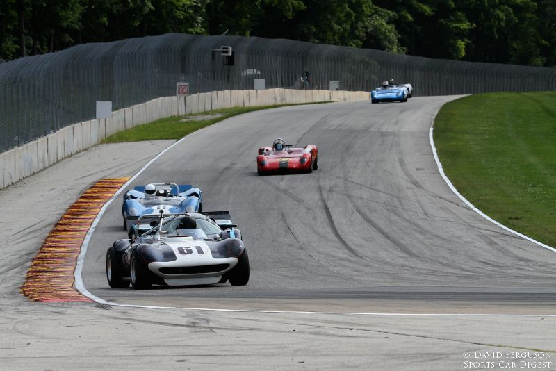 Brian Garcia in his 65 BTM Cheetah leads a group of lovely cars into turn 5.