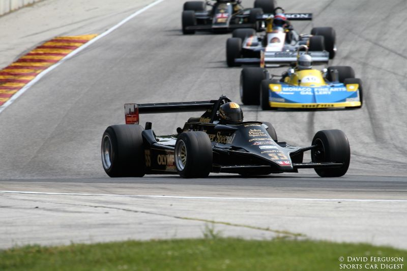 Doc Bundy, 78 Lotus 79, leads a most interesting group of cars into turn 5.