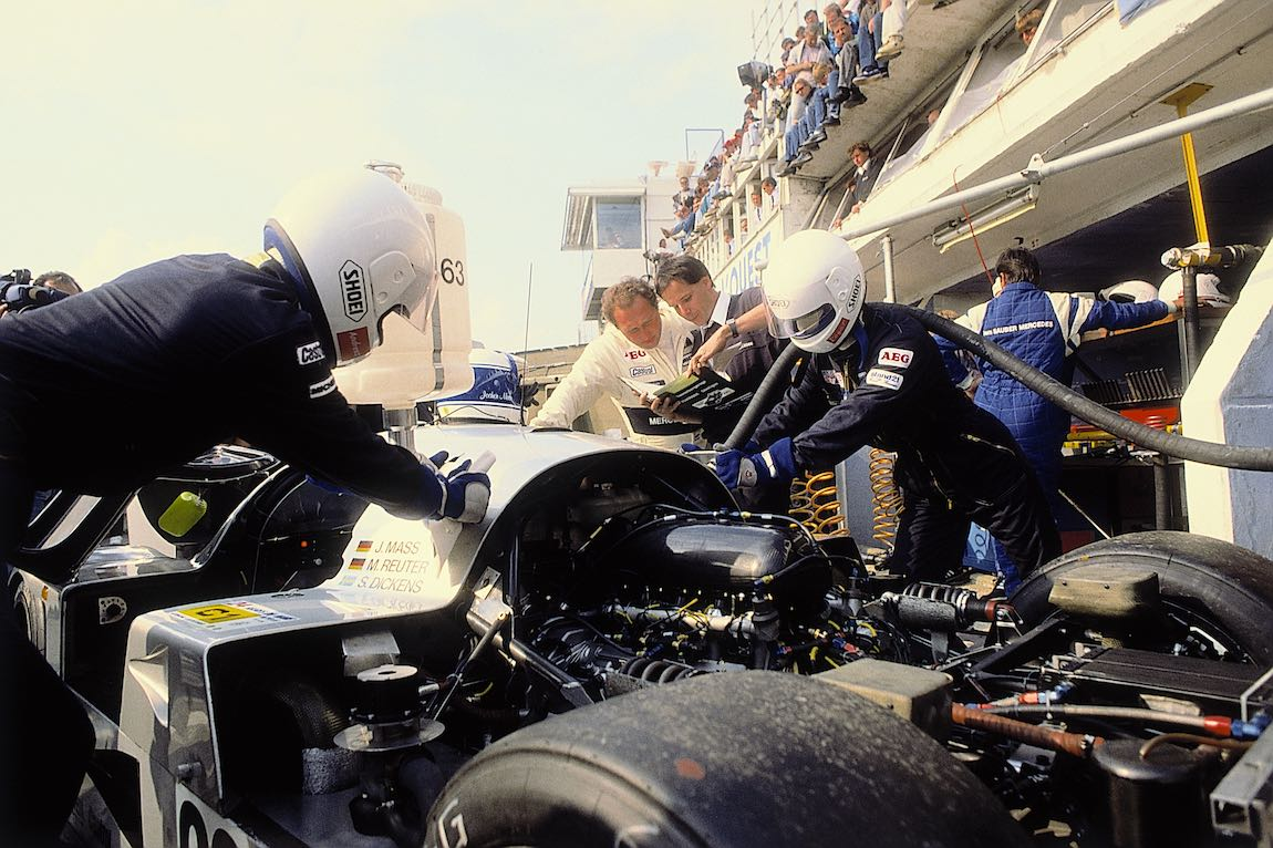 Pit stop of the car that later won, the Sauber-Mercedes C 9 sports car prototype with start number 63 (Stanley Dickens, Jochen Mass and Manuel Reuter). The Sauber-Mercedes clinched a one-two victory, and, in addition, the car with start number 62 finished in 5th place. At rear, centre: Jochen Mass.