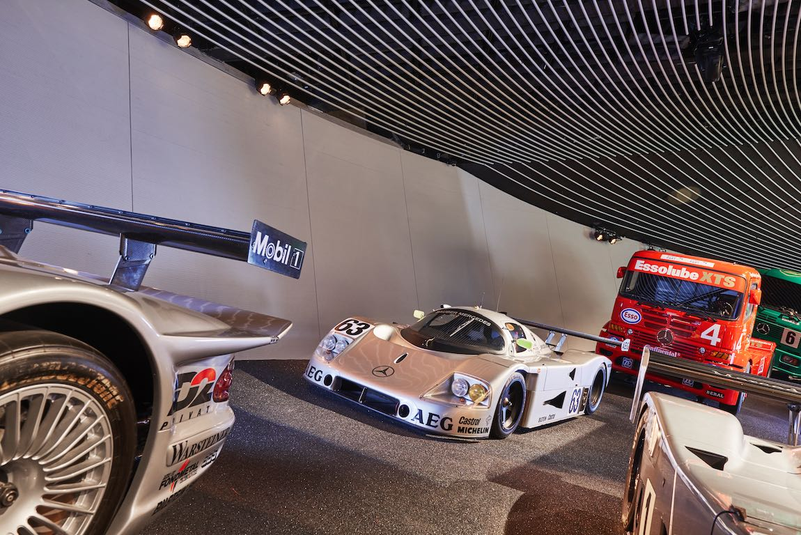 """The Le Mans 1989 winning car: Sauber-Mercedes C 9 sports car prototype with start number 63 in the high-bank curve in the Mercedes-Benz Museum, room """"Legend 7: Silver Arrows – Races and Records"""" exhibition area. The drivers were Stanley Dickens, Jochen Mass and Manuel Reuter."""