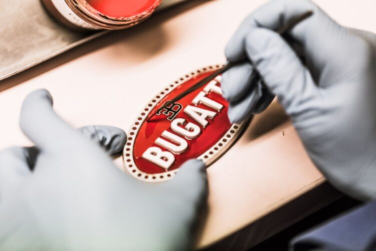 hand painting the Bugatti badge with enamel