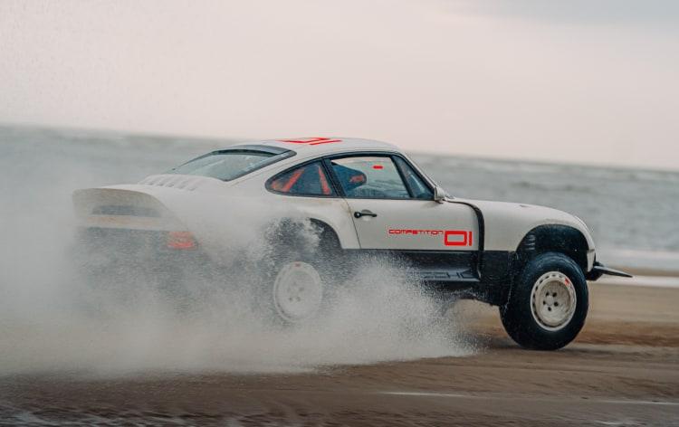 Porsche driving on beach