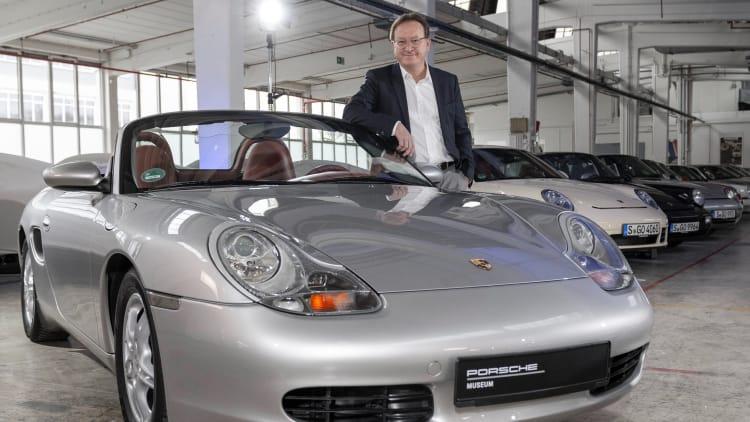 Grant Larson next the Porsche 986