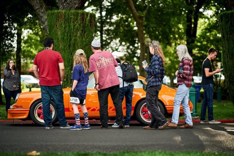 spectators looking at Porsche