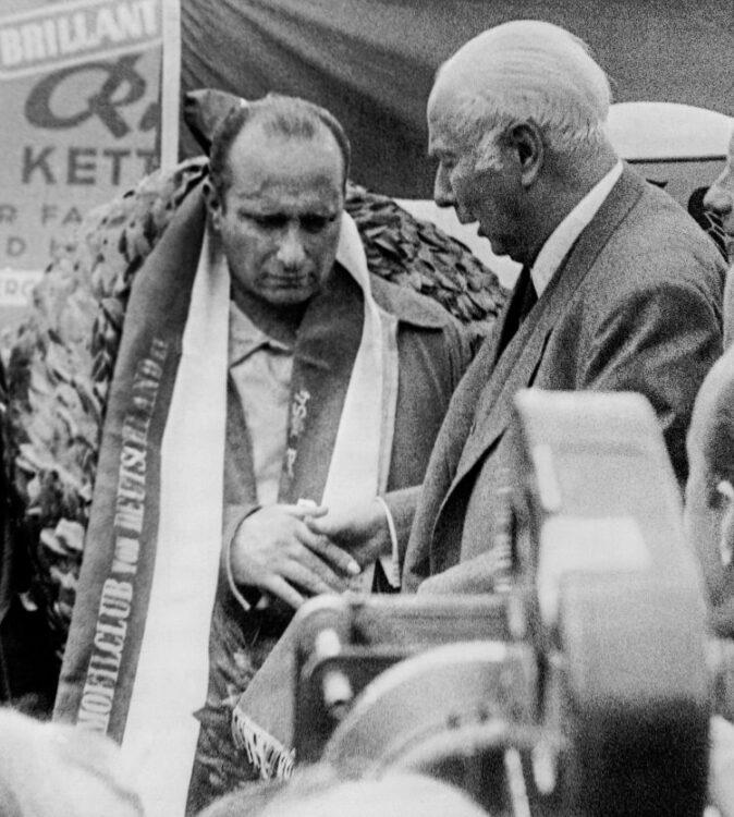 German President Theodor Heuss compliments winner Juan Manuel Fangio
