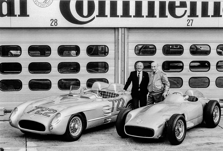 Juan Manuel Fangio (right) and Stirling Moss