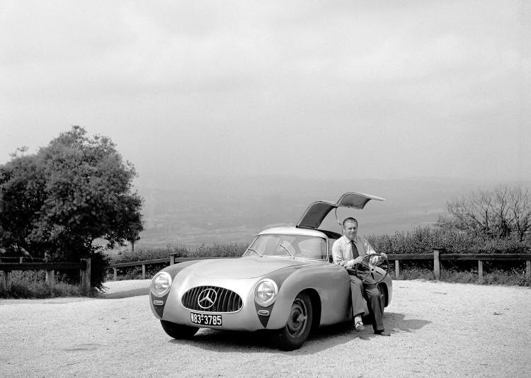 Rudolf Uhlenhaut sitting in a Mercedes-Benz 300 SL