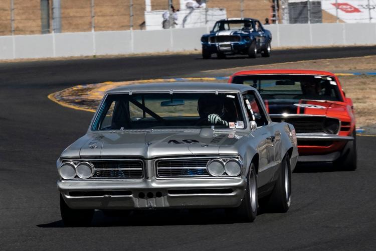 John Hildebrand - 1964 Pontiac Tempest leads into turn ten.