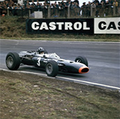 Graham Hill racing a BRM P261, British Grand Prix, Brands Hatch, Kent, 1966. Hill eventually finished third in this race. Hill was one of the first Formula 1 drivers to become a television personality as well as a racing star. He made his debut at Monaco in 1958 and went on to win 14 Grands Prix. He joined Jim Clark at Team Lotus in 1967, and in 1969 won his last Grand Prix - his fifth triumph at Monaco. He was killed in a plane crash in 1975 with five other members of his Embassy Hill team.