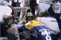 Damon Hill in his Williams-Renault, 1993. As the son of one of the legends of motor racing, Damon Hill had much to live up to when he decided to pursue a career in the sport. Having gained his first experience of Formula 1 with a few races with Brabham whilst working as a test driver with Williams in 1992, he graduated to the Williams racing team proper in 1993. He was immediately successful, helped by an excellent car, and achieved his first win in Hungary, immediately following it up with two more, at Spa and Monza. After coming close in 1994, he finally emulated his father Graham by becoming World Champion in 1996, winning six of the first nine Grands Prix of the season. His performances in the second half of the season were perceived as less impressive and he was controversially dropped from the team. The rest of his career was spent with less competitive cars, although he did secure the Jordan team's first Grand Prix victory in Belgium in 1998.