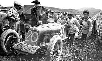 1928 - Targa Florio. 26B, with Ernesto Maserati in paddock - mechanic in car