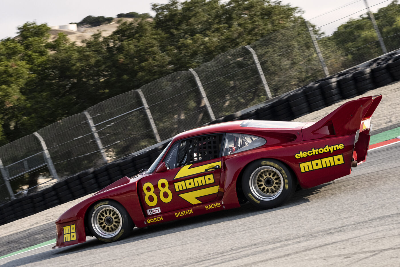 William Conner drops his beautiful and quick 1980 Porsche 935 3200 down the Corkscrew Saturday afternoon. ©2021 Dennis Gray