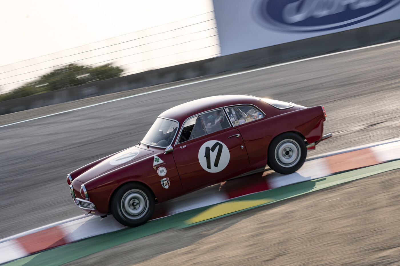 Patrick Byrne's quick 1958 Alfa Romeo Guilietta 1300 Sprint Veloce 1300 dives into the Corkscrew Saturday morning. ©2021 Dennis Gray