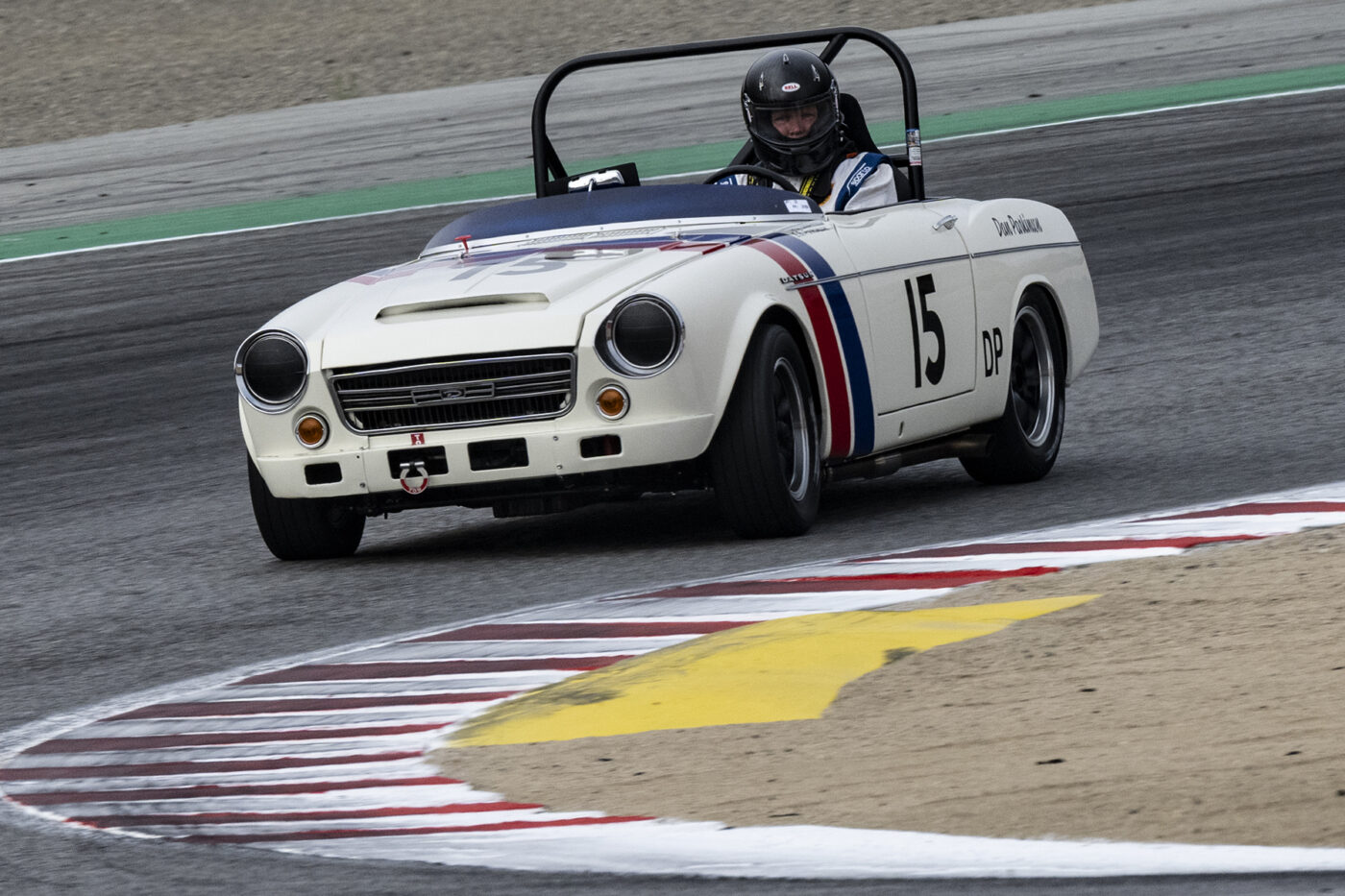 Greg Walsh in his 1966 Datsun SPL311 Roadster 2000 in turn two Sunday morning. ©2021 Dennis Gray