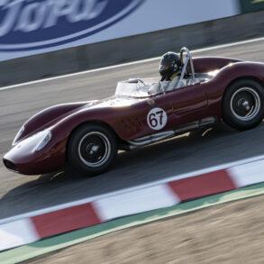 Warren Spieker's 1957 Maserati 200SI 1994 drops into the Corkscrew early Saturday. ©2021 Dennis Gray
