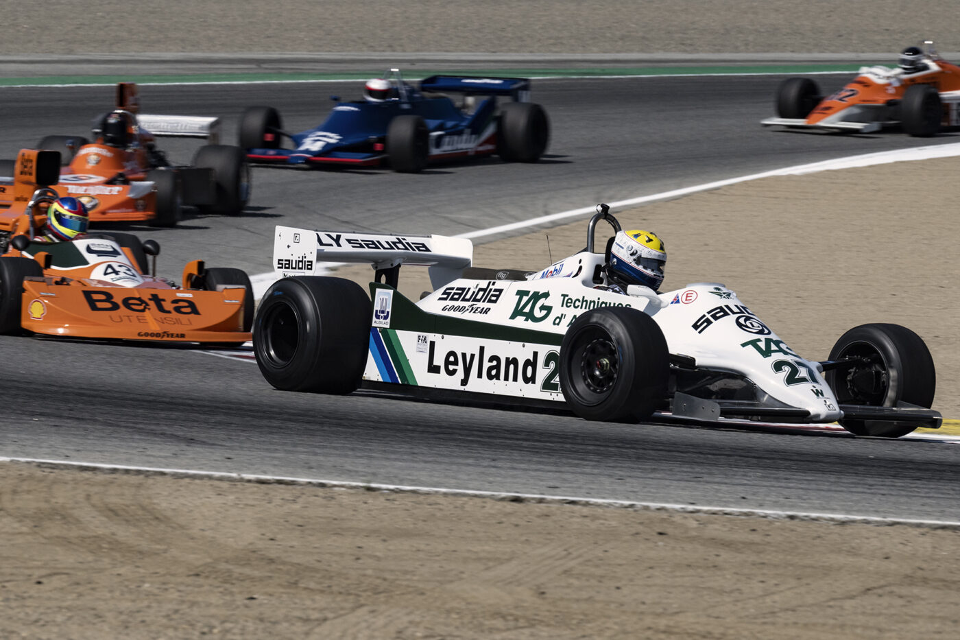 Charles Nearburg's 1981 Williams FW07C 2992 leads a tight group of Masters F1 cars through turn two Sunday morning. These guys put on a show. ©2021 Dennis Gray