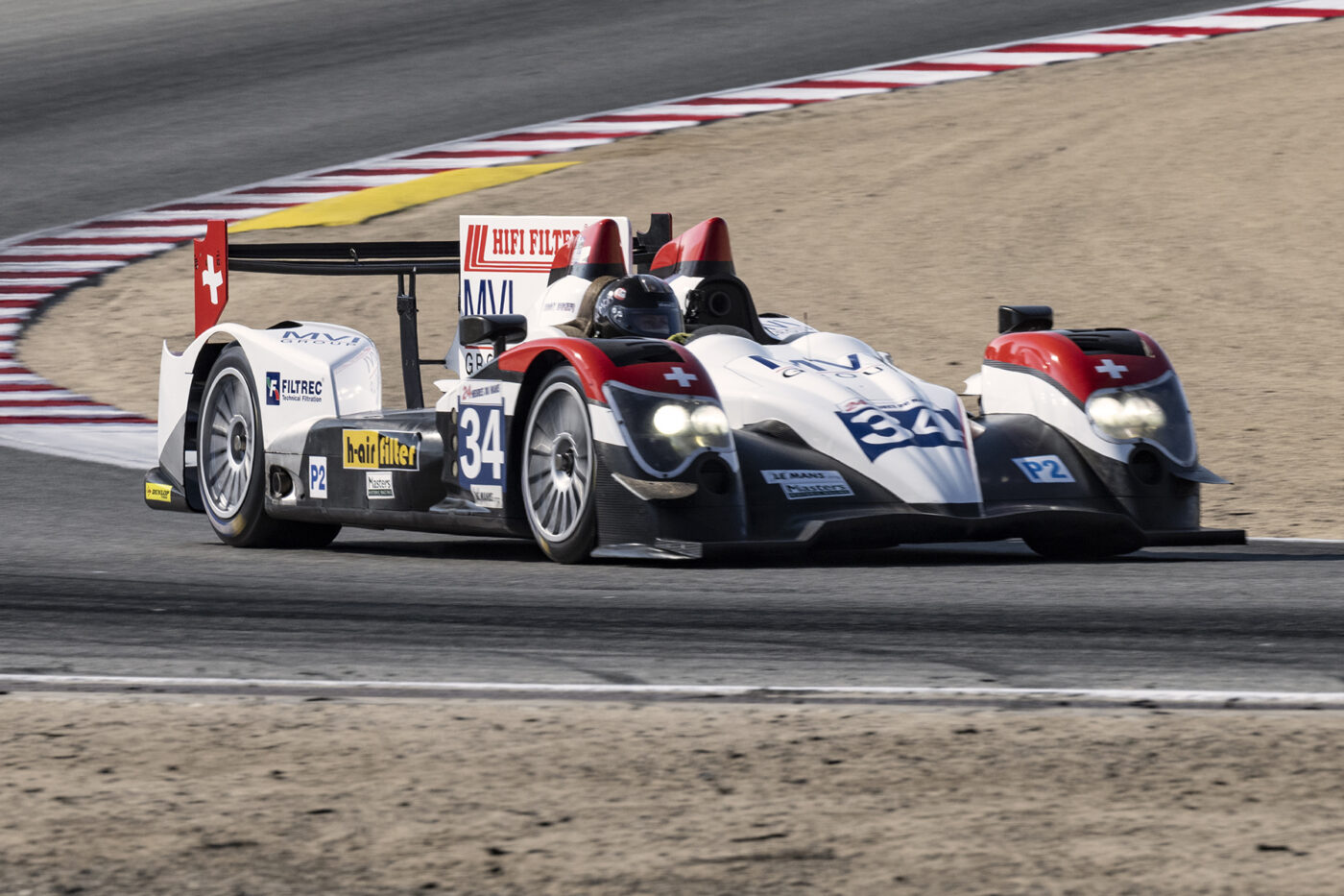 """""""Fast"""" Danny Baker in his 2011 Orca FLM03 LMP2 3600 exits turn five Saturday afternoon. ©2021 Dennis Gray"""