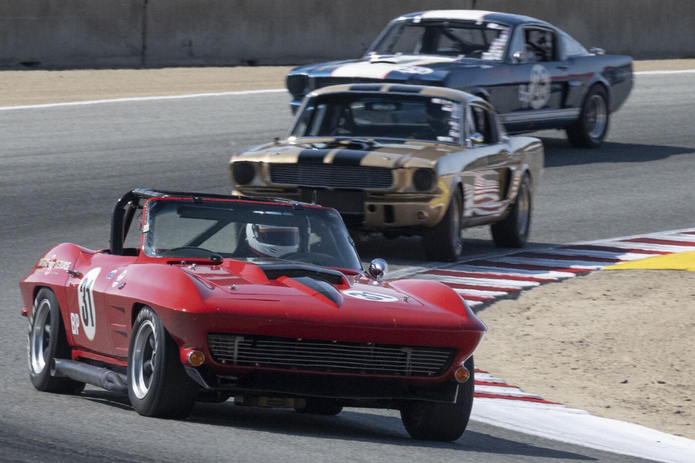 Craig Carter's 1964 Chevrolet Corvette 5360 leads through turn five Saturday aternoon. ©2021 Dennis Gray