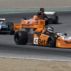 Steven Romak's 1976 MARCH 761 leads a gaggle of F1 cars through turn two. ©2021 Dennis Gray