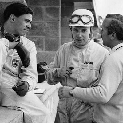Clark, Surtees and Chapman in Lotus pit