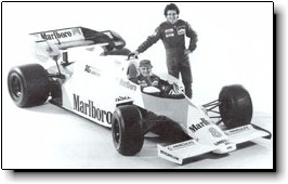 Alain Prost (standing) and 1984 World Champion Niki Lauda