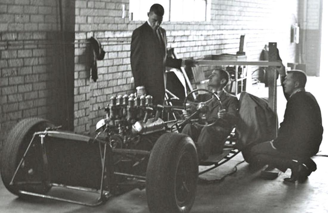 Dave Macdonald, Ken Miles and Peter Brock inspecting the CSX2287 chassis.