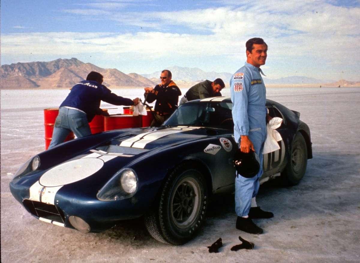 Craig Breedlove posing with the Shelby Daytona Coupe CSX 2287 at the Bonneville Salt Flats