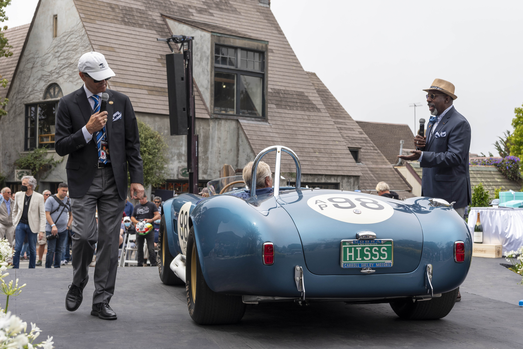 Concours on the Avenue judges inspecting a Shelby Cobra