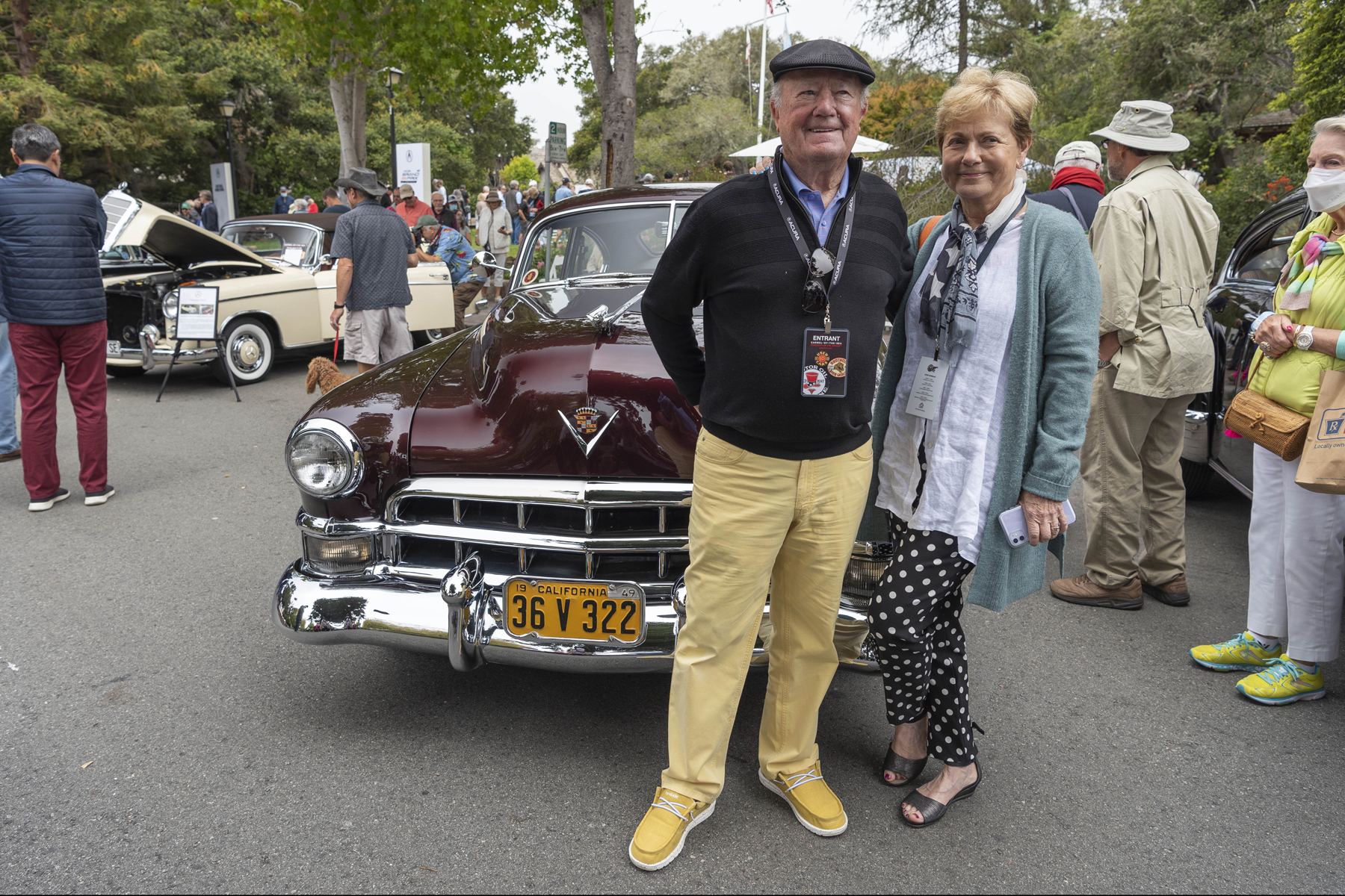 Owners of 1949 Cadillac Series 62 Sedanette standing in front of the car