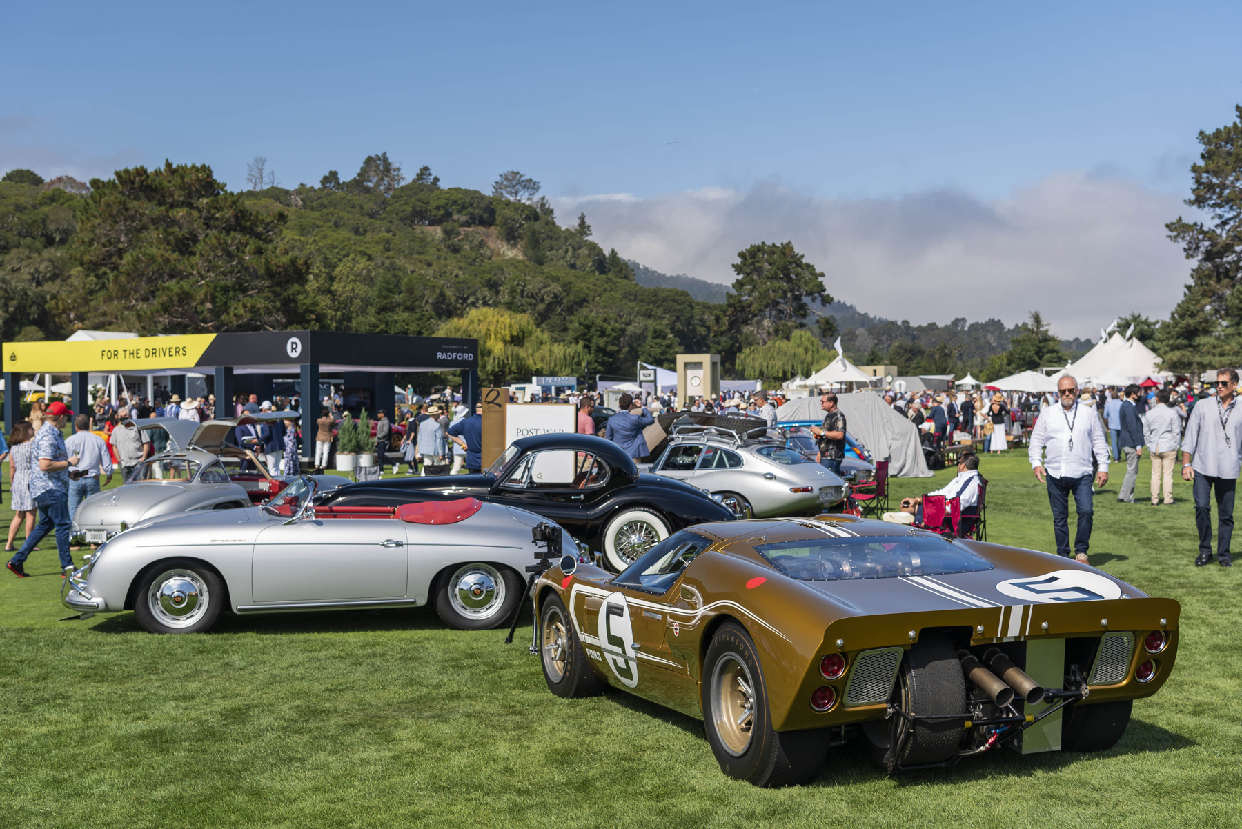 A group of vehicles at the Quail event