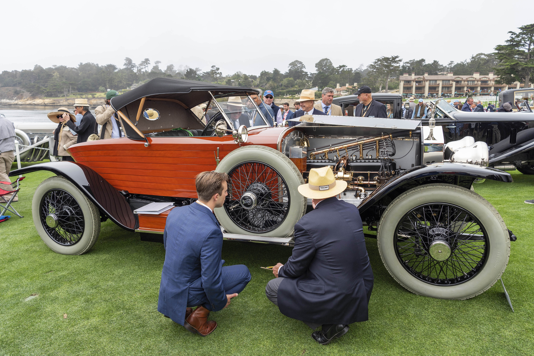 """judge inspecting the engine compartment of a 1914 Rolls-Royce Silver Ghost """"Shapiro Schebera Skiff"""""""
